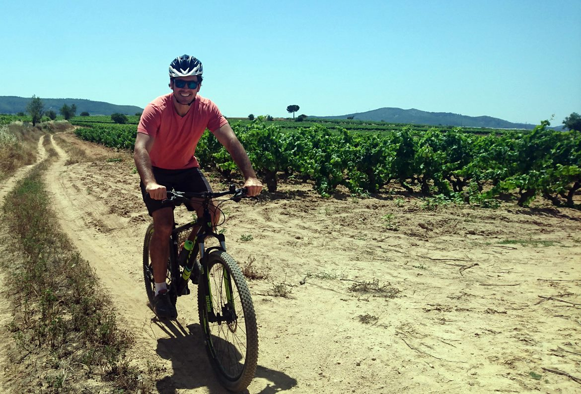 Penedes vineyards on bike. Caves Avinyó | BIKING THROUGH SPAIN